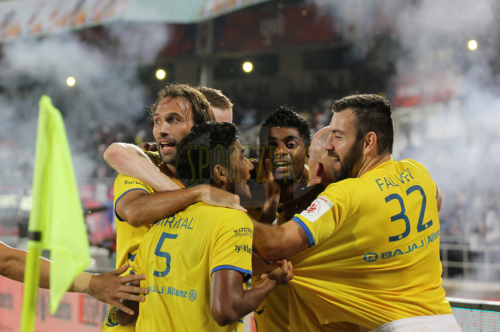 Cedric Hengbart of Kerala Blasters FC celebrates a goal with his teammates during match 17 of the Hero Indian Super League between FC Pune City and Kerala Blasters FC held at the Shree Shiv Chhatrapati Sports Complex Stadium, Pune, India on the 30th October 2014.<br /> <br /> Photo by:  Vipin Pawar/ ISL/ SPORTZPICS