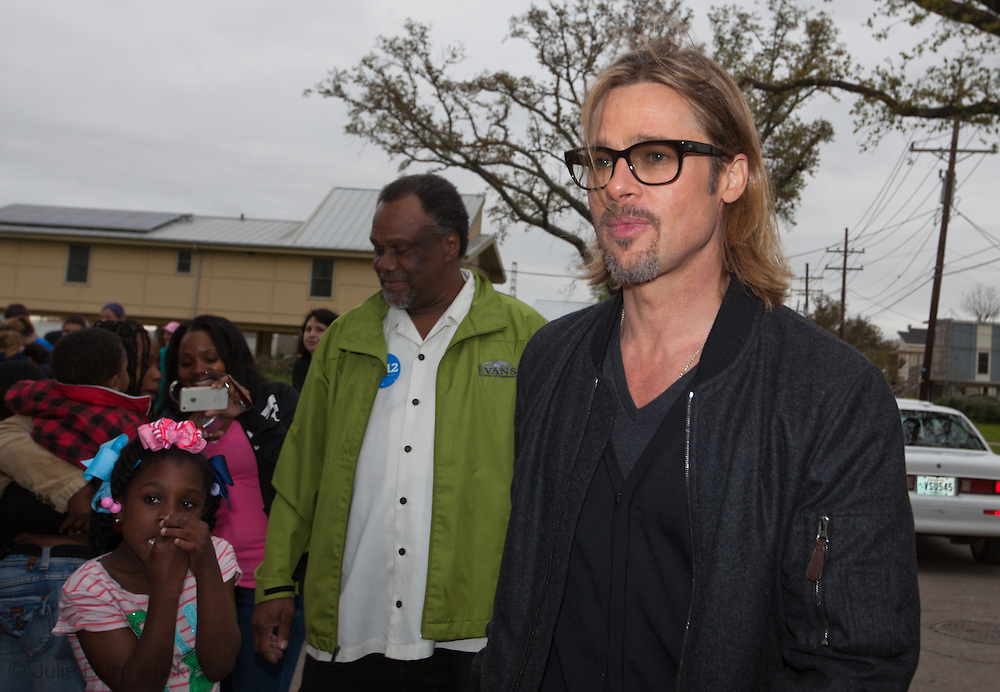 """Brad Pitt greets locals after giving  Ellen DeGeneres  a tour in the """" Make it Right """" housing project in the Lower 9th Ward of New Orleans the day before a star-studded fundraising dinner  being held in New Orleans for his foundation."""