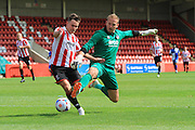 Billy Waters is brought down by Steve Maidenhall for the penalty during the Pre-Season Friendly match between Cheltenham Town and Bristol Rovers at Whaddon Road, Cheltenham, England on 25 July 2015. Photo by Antony Thompson.