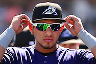 SCOTTSDALE, AZ - MARCH 09:  Cristhian Adames #18 of the Colorado Rockies adjusts his glasses during the spring training game against the San Francisco Giants Scottsdale Stadium on March 9, 2016 in Scottsdale, Arizona.  The Colorado Rockies won 8-6. (Photo by Jennifer Stewart/Getty Images) *** Local Caption *** Cristhian Adames