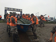 JINGZHOU, CHINA - JUNE 02: (CHINA OUT) <br /> <br /> Rescuers and the police work at accident site where a ship carrying 458 people sank on Monday night in Jianli section of the Yangtze River on June 2, 2015 in Jingzhou, Hubei province of China. A passenger ship named Dongfangzhixing (Eastern Star) carrying 458 people, including 406 Chinese passengers, 5 travel agency workers and 47 crew members aboard, according to the administration, sank at around 9:28 p.m. on Monday in the Jianli (Hubei Province) section of the Yangtze River. The captain and the chief engineer in eight people have been rescued and both claimed that the ship sank quickly after being attacked by cyclone. Chinese President Xijinping has ordered a work team of the State Council to rush to the site to guide search and rescue work, and rescue teams of Hubei, Chongqing and relevant parties to carry out all-search efforts and properly handle the aftermath.<br /> ©Exclusivepix Media