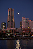 Early Morning Full Moon over Yokohama from the deck of the MV World Odyssey. Fuji X-T1 camera and 55-200 mm OS lens (ISO 800, 55 mm, f/4, 1/30 sec).