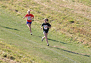 Warwick, N.Y. - Two runners compete in a girls' race at the New York State Public High School Athletic Association cross country championships at Sanfordville Elementary School on Nov. 11, 2006.<br />