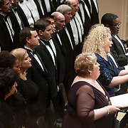 """March 6, 2012 - New York, NY : .Guest conductor Jon Oliver (not pitured) leads the Boston Symphony Orchestra featuring the Tanglewood Festival Chorus (at left) and, standing with sheet music from fore to aft, soprano Christine Brewer, mezzo-soprano Michelle DeYoung, tenor Simon O'Neill, and bass-baritone Eric Owens in Ludwig Van Beethoven's """"Missa solemnis in D Major, Op. 123 (1819-1823)' in Isaac Stern Auditorium at Carnegie Hall on Tuesday night..CREDIT : Karsten Moran for The New York Times"""