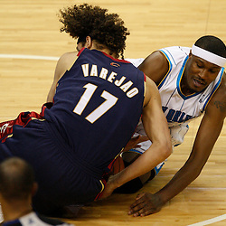 Mar 24, 2010; New Orleans, LA, USA; New Orleans Hornets forward James Posey (41) and Cleveland Cavaliers forward Anderson Varejao (17) scramble for a loose ball during the second half at the New Orleans Arena. The Cavaliers defeated the Hornets 105-92. Mandatory Credit: Derick E. Hingle-US PRESSWIRE