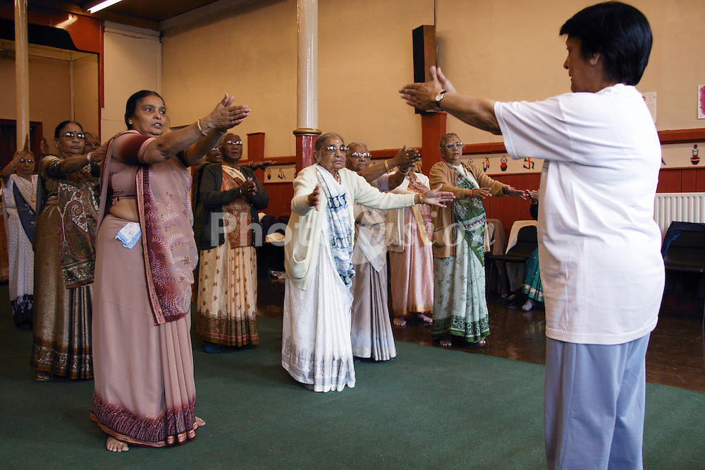 Group of elderly women taking part in exercise class,