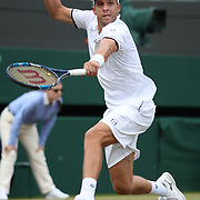LONDON, ENGLAND - JULY 12:  Gilles Muller of Luxembourg in action against Marin Cilic of Croatia in the Mens' Singles Quarter Final match on Court One during the Wimbledon Lawn Tennis Championships at the All England Lawn Tennis and Croquet Club at Wimbledon on July 12, 2017 in London, England. (Photo by Tim Clayton/Corbis via Getty Images)