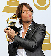 epa02013735 Australian country singer Keith Urban holds his award for 'Best Male Country Vocal Performance' at the 52nd Annual Grammy Awards at the Staples Center in Los Angeles, California, USA, 31 January 2010. The Grammys are presented annually by the National Academy of Recording Arts and Sciences of the United States for outstanding achievements in the music industry.  EPA/ANDREW GOMBERT
