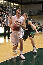 08 March 2014:  Pat Sodemann on his way to the hoop during an NCAA mens division 3 2nd Round Playoff basketball game between the St Norbert Green Knights and the Illinois Wesleyan Titans in Shirk Center, Bloomington IL