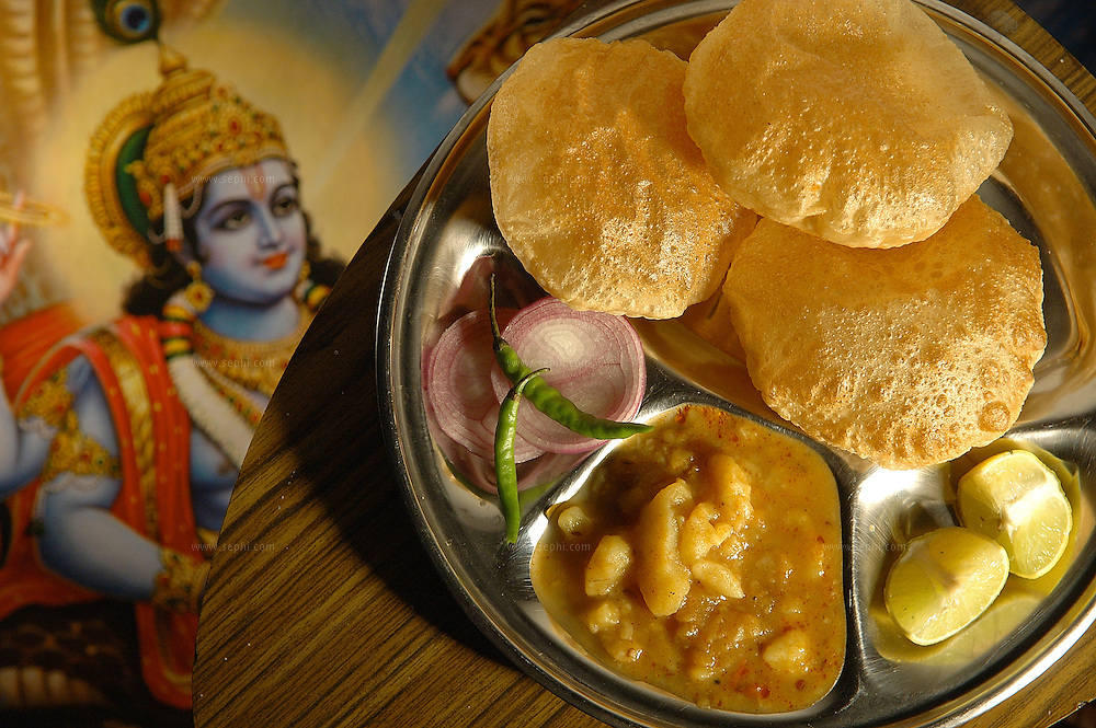 Puri Aloo - fried bread with potato in gravey ( Recipe available upon request )