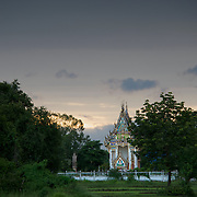 A brightly decorated Thai Temple in the evening of a typical rainy season day.
