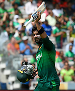 Wicket - Imad Wasim of Pakistan raises his bat to the spectators as he walks back to the pavilion after being dismissed by Mustafizur Rahman of Bangladesh during the ICC Cricket World Cup 2019 match between Pakistan and Bangladesh at Lord's Cricket Ground, St John's Wood, United Kingdom on 5 July 2019.