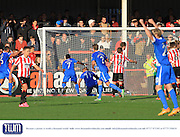 Ross Lafayette scores during the Vanarama National League match between Cheltenham Town and Eastleigh at Whaddon Road, Cheltenham, England on 17 October 2015. Photo by Antony Thompson.
