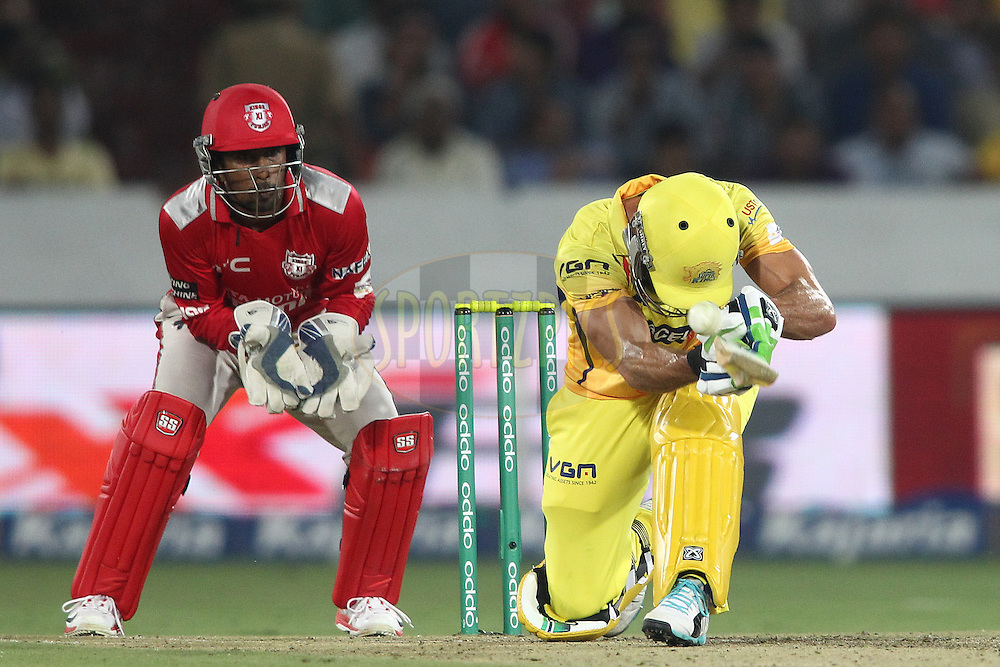 Francois Du Plessis of the Chennai Super Kings attempts to scoop a delivery during the second semi final match of the Oppo Champions League Twenty20 between the Kings XI Punjab and the Chennai Superkings held at the Rajiv Gandhi Cricket Stadium, Hyderabad, India on the 2nd October 2014<br /> <br /> Photo by:  Shaun Roy / Sportzpics/ CLT20<br /> <br /> <br /> Image use is subject to the terms and conditions as laid out by the BCCI/ CLT20.  The terms and conditions can be downloaded here:<br /> <br /> http://sportzpics.photoshelter.com/gallery/CLT20-Image-Terms-and-Conditions-2014/G0000IfNJn535VPU/C0000QhhKadWcjYs