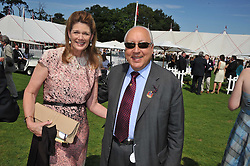 URS & FRANCESCA SCHWARZENBACH at the 27th annual Cartier International Polo Day featuring the 100th Coronation Cup between England and Brazil held at Guards Polo Club, Windsor Great Park, Berkshire on 24th July 2011.