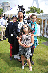 Left to right, NIMMY MARCH her son MALACHY BURKE and daughters KHAYA BURKE (taller) and LOTTIE BURKE at a luncheon hosted by Cartier for their sponsorship of the Style et Luxe part of the Goodwood Festival of Speed at Goodwood House, West Sussex on 1st July 2012.