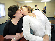 OTTSVILLE, PA - JUNE 17: Diane Chronister (L) and Kelly Jennings (R) kiss after being married by District Judge Gary Gambardella June 17, 2014 in Ottsville, Pennsylvania. The judge recently announced that he will be holding evening ceremonies in case same-sex couples find it difficult to get married now that the state's ban on same-sex marriage was struck down by a federal court. (Photo by William Thomas Cain/Cain Images)