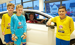 CARDIFF, WALES - Wednesday, November 11, 2015: Wales' Jonathan Williams with three local school children as part of a Vauxhall competition. (Pic by David Rawcliffe/Propaganda)