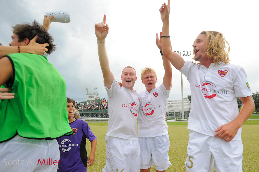 Orlando City U23s celebrate their 4-1 win over the Austin Aztex in the PDL Southern Conference Championships final at Trinity Catholic High Schooll on July 22, 2012 in Ocala, Florida. ..©2012 Scott A. Miller