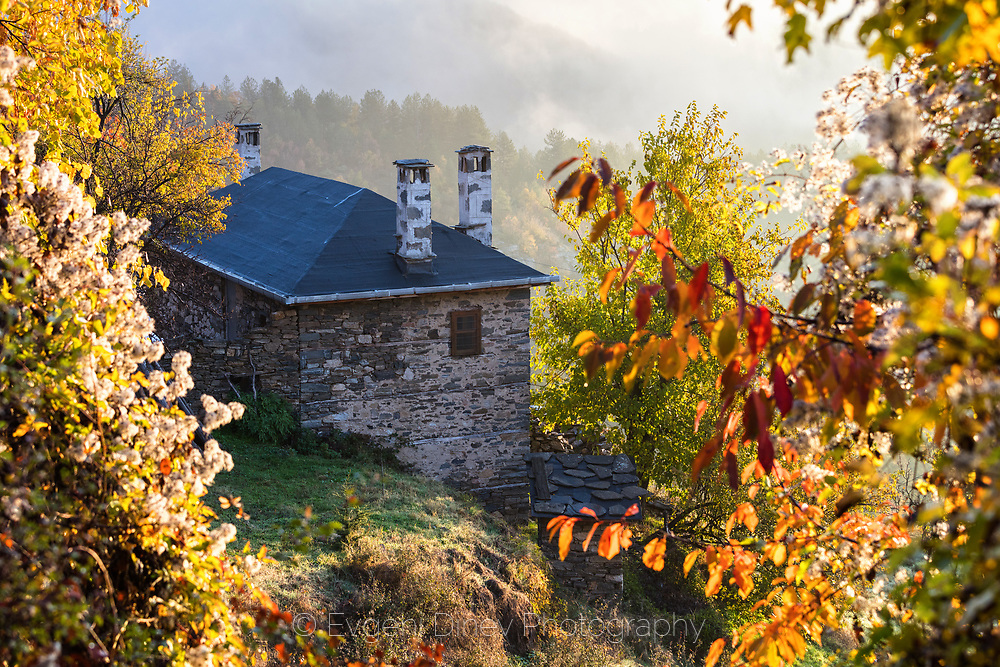 Big rural house in the mountain at autumn morning