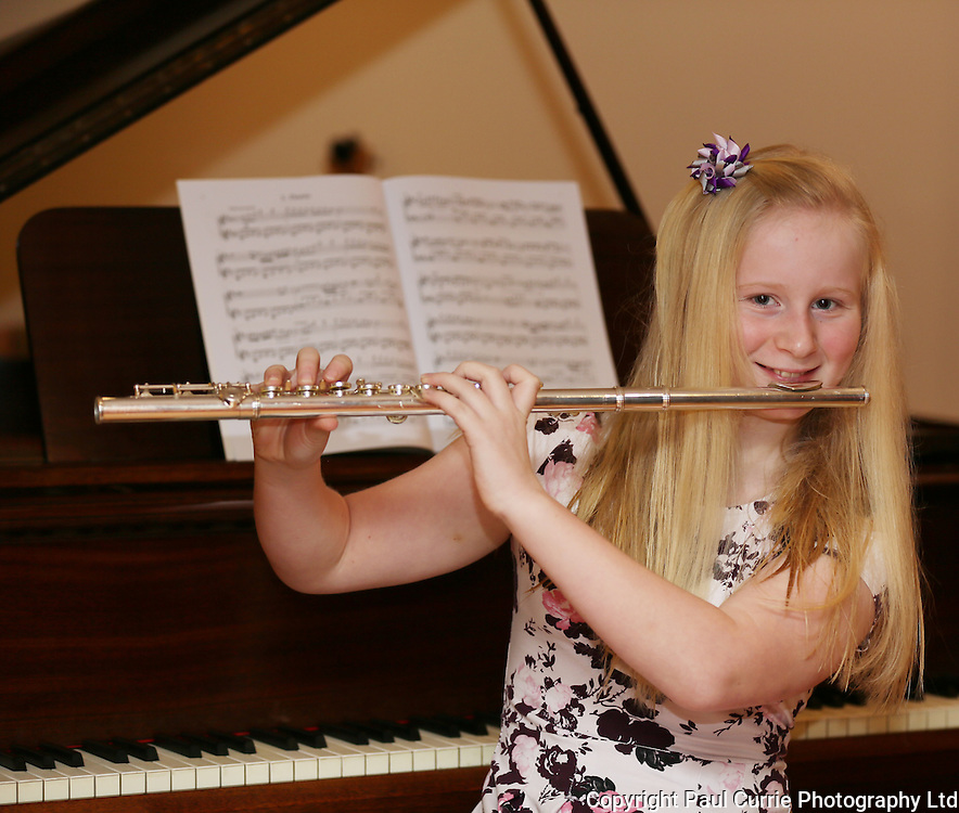 Picture shows Brioni Crowe, aged 11, who has just got a place in the National Wind Sinfonia of GB and will be performing in the 2015 Proms in the summer also picture with her brother Zac who is also a very talented piano player.<br /> Pictures by Paul Currie <br /> www.paulcurriephotos.com<br /> 07796146931