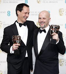 Diarmid Scrimshaw (L) and Peter Carlton, winners of the Short Film award for Swimmer , pose in the press room of the BAFTA British Academy Film Awards 2013 at the Royal Opera House in London, Britain, Sunday February 10, 2013. Photo by Imago / i-Images. UK ONLY..