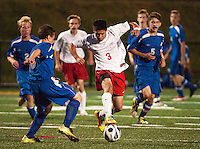 Interlakes Ben Jarves and Laconia's James Salta during Tuesday nights Division III Soccer.  (Karen Bobotas/for the Laconia Daily Sun)
