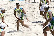Camps Bay, A player off loads the ball during the Oasis SKW Camps Bay Beach Touch Rugby Tournament held on the 2 February 2008, Cape Town, South Africa...Image © Sportzpics