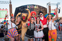 Festival goers wearing Circus fancy dress in front of the Castle Stage at Bestival 2018 Lulworth Castle - Wareham. Picture date: Saturday 4th August 2018. Photo credit should read: David Jensen/EMPICS Entertainment