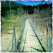 Photo shows the Fumoto suspension bridge along a walk that takes trekkers through parts of the Asagiri Plateau in Shizuoka Prefecture Japan on 22 March 2013.  Photographer: Robert Gilhooly