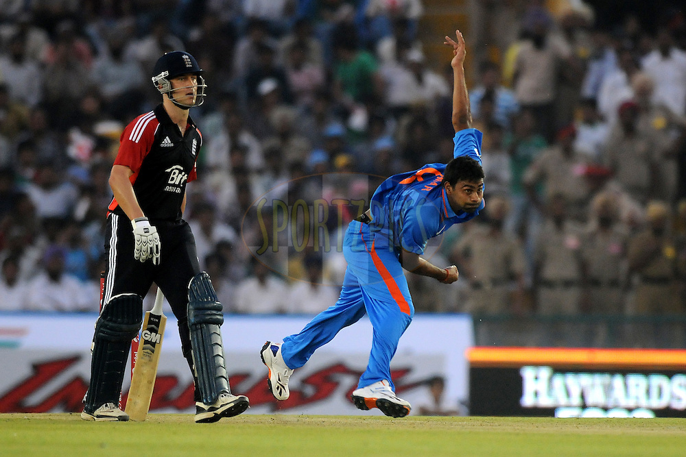 Praveen Kumar of India bowls during the 3rd One Day International ( ODI ) match between India and England held at  the PCA Stadium, Mohali on the 20th October 2011..Photo by Pal Pillai/BCCI/SPORTZPICS