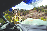 Placerville Captain John Cheroske dons his full uniform while destroying a car's windshield during the Placerville Volunteer Fire Dept. Family Picnic Saturday.  The price to destory the windshield was 50 dollars.  The money raised from the event goes directly to the Annual Scholarship Fund where the fire department gives money to a graduating area senior to help aid in furthering their education.