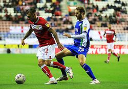Bristol City's Jack Hunt and Wigan Athletic's Nick Powell - Mandatory by-line: Matt McNulty/JMP - 21/09/2018 - FOOTBALL - DW Stadium - Wigan, England - Wigan Athletic v Bristol City - Sky Bet Championship
