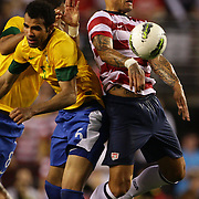 Jermaine Jones, USA, wins the ball while challenged by Sandro, Brazil, during the USA V Brazil International friendly soccer match at FedEx Field, Washington DC, USA. 30th May 2012. Photo Tim Clayton