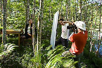 Green business stock shoot along the Snoqualmie River, Exit 38 off I90, Washington Cascades. Tim shooting while Andrew Hida holds a reflector and shades the lens.  Photo by John McElhatton.