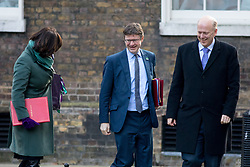 © Licensed to London News Pictures. 06/02/2018. London, UK. Secretary of State for Business, Energy and Industrial Strategy Claire Perry, Secretary of State for Business, Energy and Industrial Strategy Greg Clarke and Transport Secretary Chris Grayling arriving in Downing Street to attend a Cabinet meeting this morning. Perry is wearing symbolic green and purple colours, as today is the 100th anniversary of women's right to vote. Photo credit : Tom Nicholson/LNP