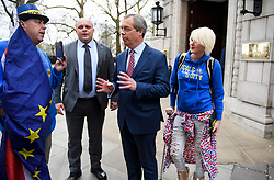 © Licensed to London News Pictures. 29/03/2018. London, UK. Former UKIP leader NIGEL FARAGE is seen being confronted by anti-Brexit campaigner MADELEINA KAY (right) while leaving Milbank Studio's following an appearance on the BBC Daily Politics program. . Photo credit: Ben Cawthra/LNP
