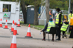 © Licensed to London News Pictures. 16/09/2020. London, UK. NHS workers waiting to carry out the COVID19 tests at Lee Valley Athletics Centre in Edmonton, north London. The Government is to publish plans to ration the coronavirus test over the coming days as members of public have complained of being unable to access to COVID19 testing.   Photo credit: Dinendra Haria/LNP