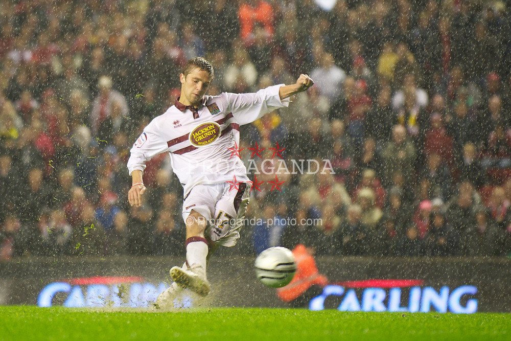 LIVERPOOL, ENGLAND - Wednesday, September 22, 2010: Northampton Town's Michael Jacobs scores from the penalty spot during a shoot-out against Liverpool during the Football League Cup 3rd Round match at Anfield. (Photo by David Rawcliffe/Propaganda)