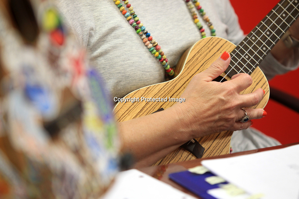 Phyllis Dye, of Brewer, plays the cords of a Red Hot Chili Peppers song durng Ukulele practice.