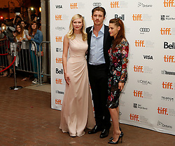 Actors KIRSTEN DUNST [L], GARRETT HEDLUND [M], KRISTEN STEWART [R] at the Red Carpet gala premiere of 'On the Road', directed by Walter Salles at the Ryerson Theatre on opening night of the 2012 Toronto International Film Festival, Thursday September 6, 2012. Photo Christopher Drost/i-Images