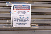 Brooklyn, NY - 27 March 2020. Restrictions on the public during the COVID-19 pandemic have led to business and government closures throughout Brooklyn's neighborhoods. A sign taped to a shuttered Social Security office on Nostrand Avenue announces the closure of the office until further notices. Although services are available online, many people who use the office do not have internet access at home, and since libraries are closed, public access is limited.