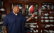 Former Dallas Cowboys guard Larry Allen, Jr. poses for a portrait with his Offensive Game Ball from the Cowboys win over the Panthers, 16-13, in 2000, at his home in Danville, California, on June 27, 2013.  Allen will be inducted into the NFL Hall of Fame during the Enshrinement Ceremony at Fawcett Stadium in Canton, Ohio, on August 2, 2013. (Stan Olszewski for Fort Worth Star-Telegram)