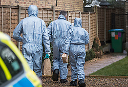 © Licensed to London News Pictures. 07/03/2018. Twickenham, UK. Police forensics are seen at a property in Twickenham, south London where the body of a woman in her 40s was found with stab wounds on Monday evening. An hour earlier he bodies of two young boys, aged 7 and 10, and their father, were discovered at the foot of Birling Gap cliffs on the south coast. Photo credit: Ben Cawthra/LNP