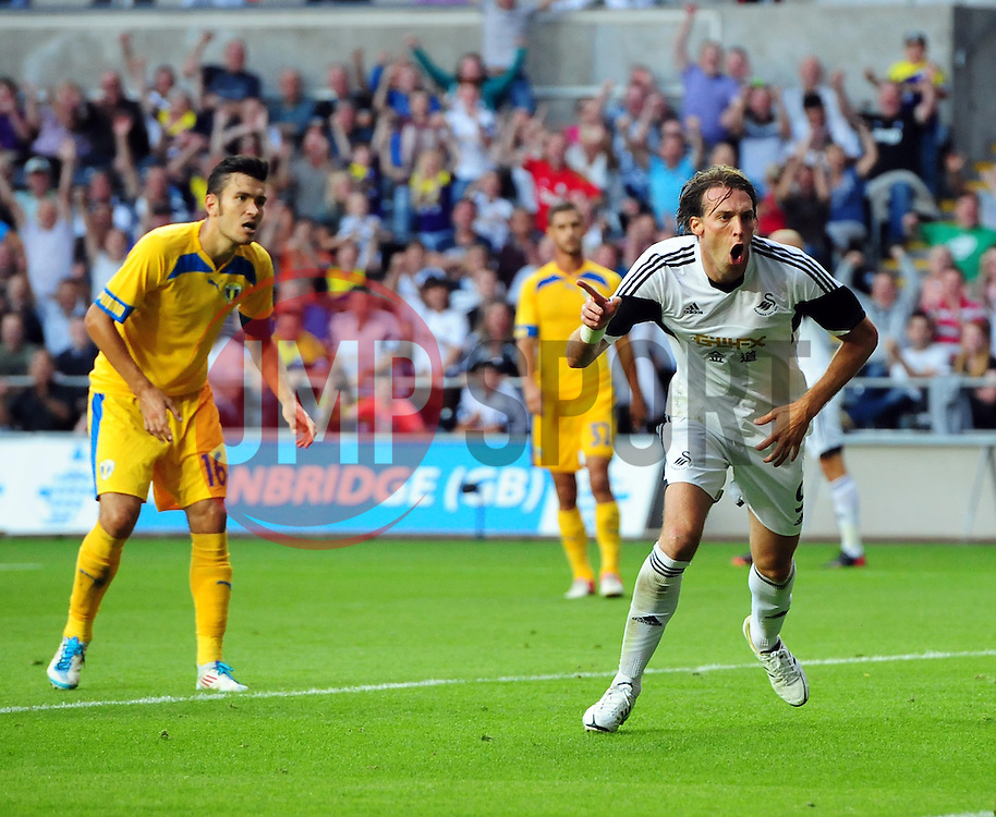 """Swansea City's Michu celebrates  - Photo mandatory by-line: Joe Meredith/JMP - Tel: Mobile: 07966 386802 22/08/2013 - SPORT - FOOTBALL - Liberty Stadium - Swansea -  Swansea City V Petrolul Ploiesti - Europa League Play-Off EDITORIAL USE ONLY. No use with unauthorised audio, video, data, fixture lists, club/league logos or """"live"""" services. Online in-match use limited to 45 images, no video emulation. No use in betting, games or single club/league/player publications"""