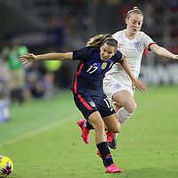 United States forward Tobin Heath (17) runs past England midfielder Keira Walsh (4) during the first match of the 2020 She Believes Cup soccer tournament at Exploria Stadium on 5 March 2020 in Orlando, Florida USA.