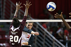 02 November 2012: Leighann Hranka powers a hit past Christine McCartney  during an NCAA womens volleyball match between the Missouri State Bears and the Illinois State Redbirds at Redbird Arena in Normal IL