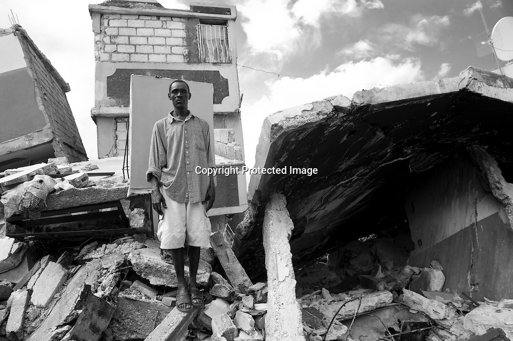 Nazaire Ifael, 53, lives in a tent with friends. On the day of the earthquake, he felt the tremors as he did some welding work in Leogane, close the epicenter. He called home, again and again, but was unable to get through to his family. He made his way home to find it had collapsed, totally, killing his wife, her sister, and his 16-year old daughter. He pulled their bodies from the rubble and buried them himself in a small patch of soil on the side of the street. He wants to go back to work, but there's no electricity for his welding equipment.