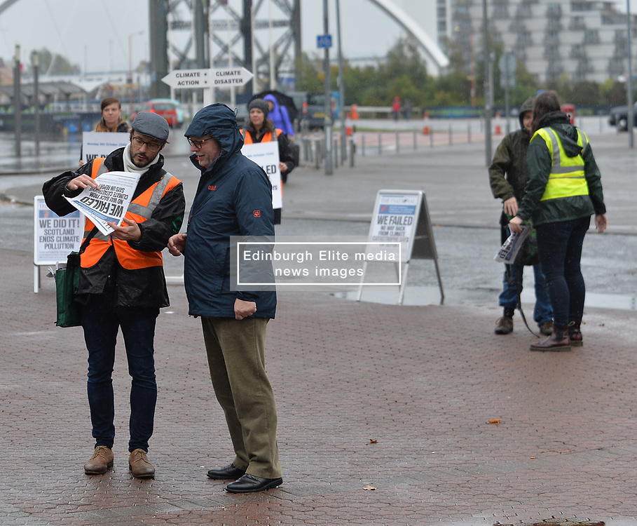 Pictured: Friends of the Earth Scotland handed out spoof newspapers from 2040 to highlight the issue of climate change to delegates bedore the SNP autumn conference in Glasgow.<br /> <br /> © Dave Johnston / EEm