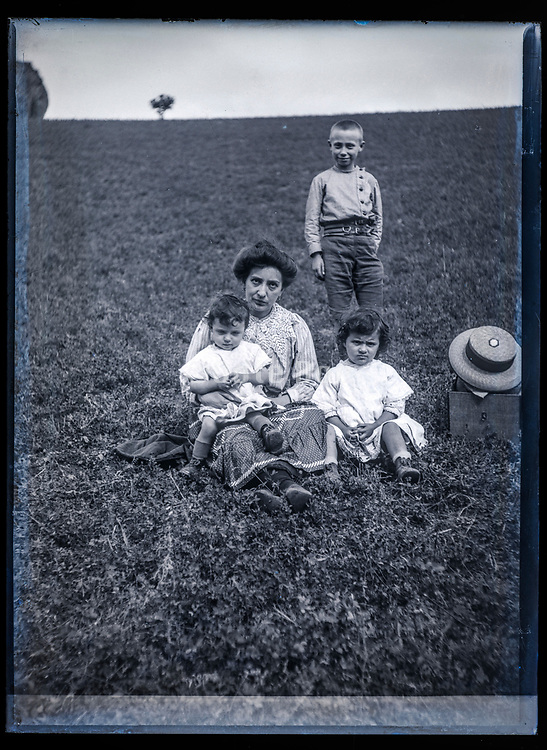 mother with children in a field France ca 1920s